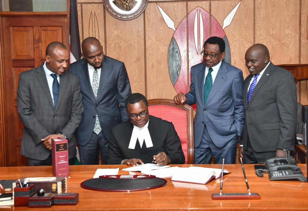 Speaker of the Senate, Rt Hon Kenneth Lusaka signs Suit Papers in the Presence of then-House Leadership and Chair Justice - Legal Affairs | July 2019